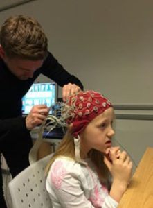 The project have investigated whether different types of math math learning strategies changes the way children solves math problems. On the picture mounting of the hood which is used for recording brain activity during solving of math problems. Credit: Image courtesy of Faculty of Science - University of Copenhagen